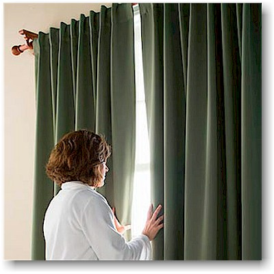 Add a blackout liner to your new window coverings. These prevent light from shining in and can be great for people who sleep during the day and new parents wanting to encourage good sleeping habits in infants and toddlers.